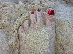 Twinkle toes, in the sand, are now chipped and ugly.