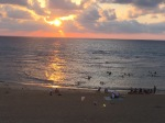 Muslims and Jews, cooling off at sunset, in the golden Mediterranean